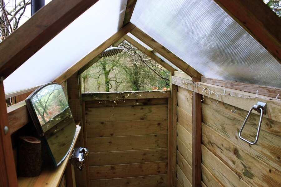 Small Space Living That Inspired Our Van Conversion - outdoor shower in converted shed