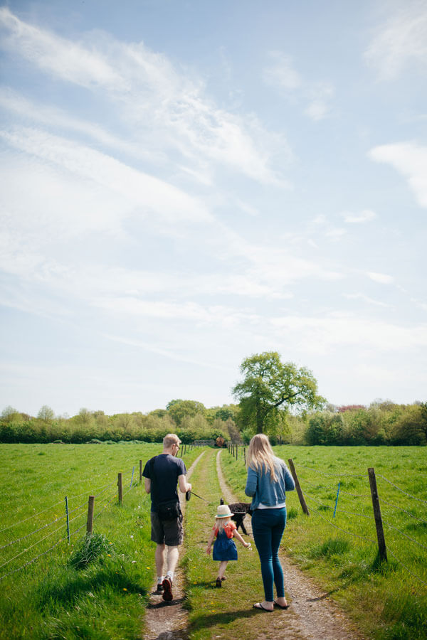 Leaving This Life We Built - family walking in the countryside