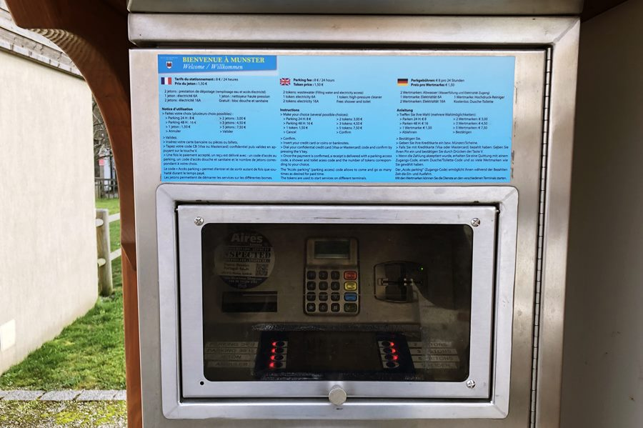 Motorhome aire payment machine in Munster, France - exploring Munster and finding storks