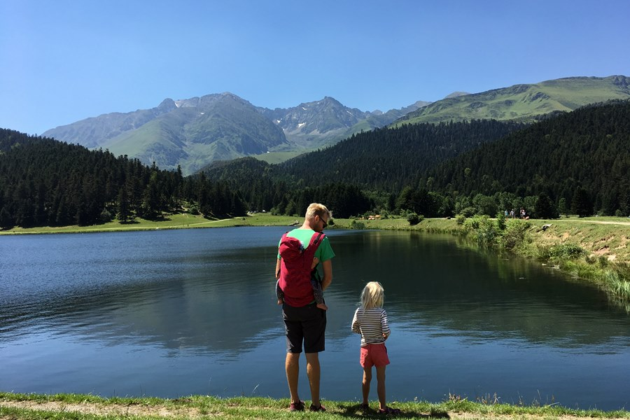 Dad and daughter by mountain lake - Family adventure films