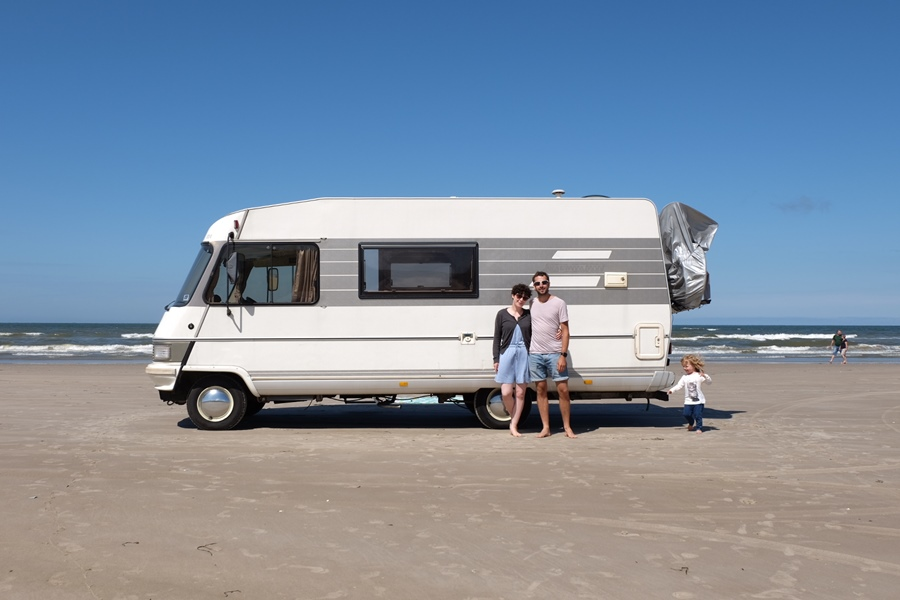 Van life family on the beach in Denmark - New Life In Italy After Family Van Life Adventure